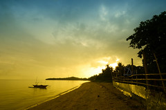 Only in Iloilo, Philippines. (danmocs) Tags: sunset vacation sky cloud beach boat pacific outdoor yello iloilo