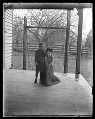 Victorian photograph of a woman and young boy on a front porch in Fallston, Maryland (Remsberg Photos) Tags: family boy blackandwhite usa vintage child antique mother maryland son historic creepy porch scanned motherhood kneeling glassplate fallston harfordmd
