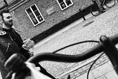 L1020317_v1 (Sigfrid Lundberg) Tags: people man lund bicycle 35mm skne wine sweden cobblestones carlzeiss biogon grnegatan kattesund lundbybike biogont235 35mmf20zmbiogon
