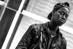 ... proud & POV!!! (Fede Falces ( ...... )) Tags: barcelona boy portrait people urban blackandwhite bw black look lines proud contrast cool eyecontact dof angle noiretblanc pov candid olympus streetphoto f18 bboy
