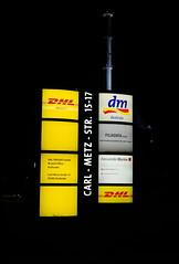 Signs (christian.riede) Tags: white signs black schilder yellow dark darkness nacht alexander karlsruhe dm schornstein freight kamin dhl dunkelheit brkle filiadata carlmetzstrasse rheinhafenkraftwerk