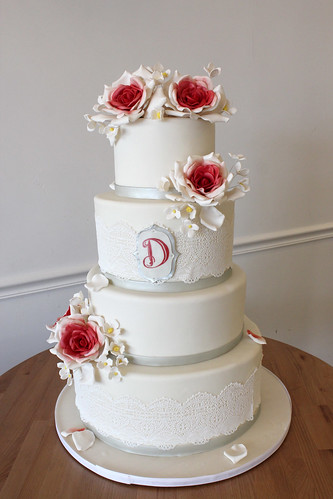 White Wedding Cake with Sugar Lace and Large Red Ombre Flowers