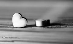 Heart to Heart (.Nabiki.) Tags: light shadow blackandwhite stilllife white black macro love closeup monocromo nikon candy heart sweet details ombre dolce luci f18 cuori bianco cuore nero amore biancoenero particolari caramelle d90 caramella nikond90