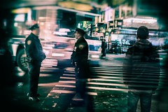 Main Street Flushing (Rob Castro) Tags: street longexposure travel people urban newyork blur horizontal youth 35mm asian mainstreet uniform chinatown cops traffic outdoor availablelight doubleexposure candid existentialism streetphotography surreal police nypd rangefinder queens nighttime motionblur citylights finepix fujifilm grainy urbanism vignette apathy youngman popo flushing selectivefocus deepthoughts unsuspecting newyorksfinest busystreet nightduty horizontalformat xpressus xpro1 allxpressus lensvignette hollywoodlook 35mmxflens unsuspectingprotagonist iamgenerationimage