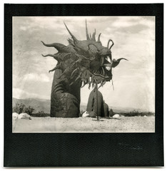 the sea serpent. borrego springs, ca. 2015. (eyetwist) Tags: eyetwistkevinballuff eyetwist desert seaserpent dragon ricardobreceda metal sculpture art borregosprings california polaroid spectra pro quintic 125mm f10 impossible bw image blackwhite polaroidspectrapro polaroidquintic125mmf10 impossiblebwspectra pz black white blackframe mono monochrome sooc film analog analogue ishootfilm instant integral impossibleproject monster giant huge beast sharp american west breceda borrego springs dry arid galletameadows welding sandiego skyart saltonsea sonorandesert sonoran yaquipass rust rusty iron steel welded anza anzaborrego teeth fangs tongue sea serpent dragonbreath america americana americantypology