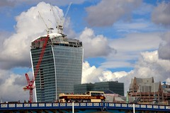 business as usual (doods-off/on) Tags: city bridge blue red sky bus london clouds buildings cloudy crane tourist