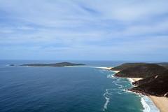 Fingal Bay (PhillMono) Tags: ocean new sea cloud lighthouse beach wales island bay coast sand nikon waves south shoreline australia shore vista coastline dslr causeway fingal d7100