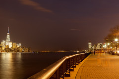 Lower Manhattan and Hoboken Waterfront (Erin Cadigan Photography) Tags: city newyorkcity longexposure bridge light urban newyork reflection tourism water horizontal architecture night dark photography lights jerseycity cityscape waterfront view darkness manhattan famous worldtradecenter reflect nighttime hudsonriver wtc lighttrails hoboken lowermanhattan timedexposure verrazano verrazanonarrows freedomtower nationalkidneyfoundation