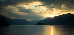 sunset at Lake Como (Kevin Heggie) Tags: longexposure sunset italy mountains reflection clouds sony bellagio sunrays lakecomo lombardia sangiovanni sigma1020mm a65 sonydslr sonya65