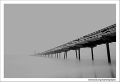 Giornata nebbiosa (Gianluca Longu) Tags: life sardegna sea bw italy fog clouds canon reflex italia mare sardinia natura ponte panoramica dettagli nebbia acqua reflexions cagliari cala naturalmente lungaesposizione nd110