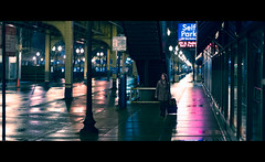 A girl walks home alone at night (One_Penny) Tags: street city travel urban woman usa chicago colors girl rain night reflections movie photography lights town illinois downtown alone unitedstates walk candid streetphotography cinematic tones canon6d