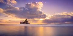 Sunset at Karakare (sandflyphoto) Tags: longexposure sunset sea newzealand seascape beach clouds landscape evening twilight sundown dusk auckland nz sunrays tasmansea piha karekare karekarebeach panatahi aucklandwestcoast panatahiisland