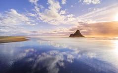 Panatahi reflections (sandflyphoto) Tags: longexposure sunset sea newzealand seascape beach clouds landscape evening twilight sundown dusk auckland nz sunrays tasmansea piha karekare karekarebeach panatahi aucklandwestcoast panatahiisland