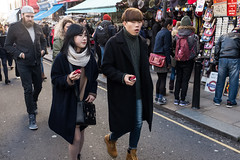 The Kooples with red velvet (Gary Kinsman) Tags: london fashion scarf couple candid streetphotography streetlife hip nottinghill w11 portobelloroad redvelvet 2016 portobelloroadmarket thekooples fujifilmx100t fujix100t