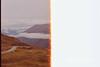 2013-Nov-07-NZ-17.jpg (mikelindle) Tags: 35mm canona1 crownrangeroad film kodak landscape nz nature newzealand slr southisland travel view wild adventure burn clouds destruction highway iso400 kodakfilm lightburn lightleak oldcamera oldfilm roadtrip scorch singe vantagepoint arrowjunction otago