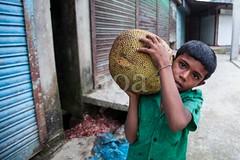 5D8_7209 (bandashing) Tags: england fruit manchester child heavy spikes sylhet bangladesh carry jackfruit socialdocumentary childlabour aoa bandashing noyabazar akhtarowaisahmed boroshala