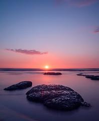 Red (lizcaldwell72) Tags: light newzealand sky water sunrise rocks oceanbeach hawkesbay