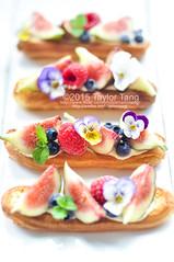 Fig berry eclair (TailorTang) Tags: stilllife food dessert 50mm fig pansy puff blueberry raspberry violets pansies eclair pateachoux 5014 foodphotography violas mintleaf edibleflower cremepatisserie