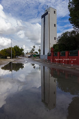Meda riflessa (Antonio Ciriello) Tags: light sky italy reflection water rain clouds san italia nuvole cielo acqua pioggia puglia luce meda fanale taranto vito riflesso seamark sanvito aulia