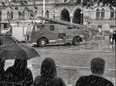 Wet Chester Mono (foggyray90) Tags: chester fireengine umbrellas raining wetpavement
