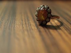 Inheritance (haint_blue) Tags: old light shadow stone canon circle gold shiny dof bokeh stones antique jewelry ring opal oval inheritance citrine zebrawood macromondays macromonday 24mmmacro canoneos70d