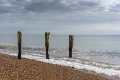 Sea-Shaped at Shoreham-by-Sea (Cirrusgazer) Tags: sky seascape sunshine clouds three wooden shaped smooth pebbles calm worn weathered posts upright cobbles groyne shorehambysea eroded sonya7r fe55mmf18za