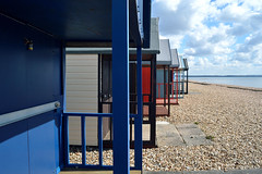 Calshot Huts (crhobbs89) Tags: sea sky sun water sand peace stones huts solent