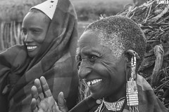 """Find a reason to smile"" - Maasai - Tanzania - Africa (TLMELO) Tags: africa friends boy portrait woman baby kilimanjaro hat mom tanzania kid women bravo child brothers retrato african poor son boring mount angry criana pobre tribe serengeti menino masai maasai tribo africana africano kilimanjaromount"