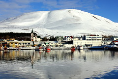 Hsavk (Freyja H.) Tags: ocean blue winter sea sky white house snow reflection building ice church harbor boat iceland ship village vessel hsavk hsavkurkirkja hsavkurfjall hsavkharbour