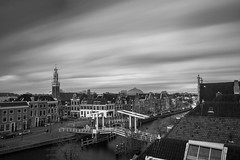 Spaarne - Haarlem, The Netherlands (Dutchflavour) Tags: city longexposure blackandwhite bw holland church haarlem netherlands spaarne skyline river cityscape centre nederland citylandscape gravestenenbrug