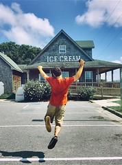 (julieannesjones) Tags: summer portrait color happy jumping action joy northcarolina excited nagshead icecream midair