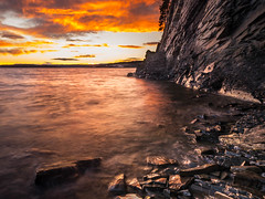 Late sunset at the rocky shores (spookst) Tags: longexposure orange clouds wow island rocks windy shore