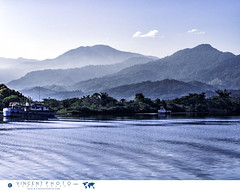 The landscape as seen from the port of the town of La Ceiba in Honduras from which offers ferry connections to the islands of Utila and Roatan. (Vincent Demers - vincentphoto.com) Tags: ocean voyage trip travel sea mer mountain tourism latinamerica water port montagne landscape boat town eau ship honduras laceiba caribbean bateau paysage tropics touristattraction tourisme centralamerica travelphotography travelphoto spanishculture tropiques traveldestination tropicalclimate photographiedevoyage gulfofhonduras bayofhonduras photodevoyage climattropical lieutouristique carabes travellocation destinationvoyage cultureespagnole ocan amriquecentrale amriquelatine baieduhonduras golfeduhonduras