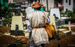 2015 - MEXICO - Zinacantn - At the Cemetery - 3 of 5 (Ted's photos - For Me & You) Tags: man male cemetery hat mexico belt nikon guitar crosses d750 cropped cowboyhat vignetting chiapas guitarplayer chamula chiapasmexico zinacantn tedmcgrath tedsphotos nikonfx zinacantnchiapas tedsphotosmexico nikond750 zinacantnmexico