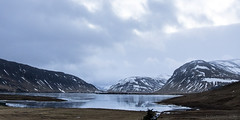 In this glass world, we stop feeling pain (lunaryuna) Tags: winter sky panorama lake snow mountains ice weather rock reflections season landscape frozen iceland mood lunaryuna naturalmirror thecoloursofcold seasonalwonders skyofglass