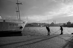 Bosphorus angling (decafeined) Tags: shadow sea blackandwhite bw black monochrome turkey boat fishing nikon istanbul jig tamron vapur bnw bosphorus tr jigging karaky angling eminn newmosque d7200