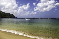 Calm Castara (LifeLover4) Tags: beach clouds landscape boats outdoors island sand rainforest tropical caribbean tt polarized tobago circularpolarizer westindies trinidadandtobago frigatebirds pirogues lifelover4 stickneydesign