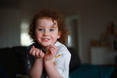 Tegen (Beccy Melling) Tags: portrait cute window girl beautiful smile pose hair children happy 50mm toddler pretty child little joy posing curls naturallight cutie cheeky curly annie 5d f18 joyful beccymelling 5dmarkiii