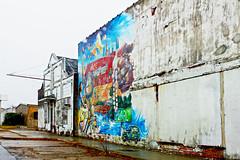 Pearl District in the Rain (susancvineyard) Tags: street city urban oklahoma rain mural colorful cityscape diverse urbandecay grunge pearldistrict tulsa charming rundown susanvineyard pearlbusinessdistrict