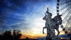 """The Sky is up above the roof"" (gcarabin) Tags: sunset sky horse paris bird monument animals wheel statue angel cheval ride gull saturday manège oiseau thebigwheel lagranderoue ridinghall"