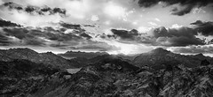 Dragon mountains BW (Adobe Garamond) Tags: blue sky bw mountain black mountains rock clouds landscape high colours shadows shine risk desert spectrum vibrant hill hard rocky away strong far unexpected shimmer distant theeth
