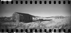 Sprocket Rocket (No Stone Unturned Photography) Tags: arizona blackandwhite abandoned film monochrome 35mm lomo lomography kodak rocket expired 800 sprocket