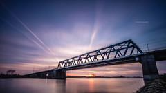 Spoorbrug Deventer (Lefers.) Tags: bridge sunset sky water river landscape long exposure fuji filter le lee rails f4 hitech deventer ijssel overijssel formatt 1024mm