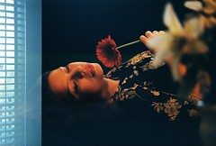Untitled #7 (M. Beln Banega) Tags: flowers portrait people woman window girl 35mm colours indoor romantic analogue oriental analogic