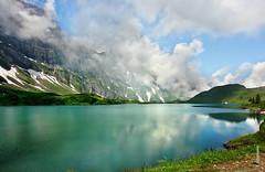 Trbsee (welenna) Tags: blue schnee summer sky mist mountain lake snow mountains alps water landscape switzerland see wasser view swiss himmel wolken blumen berge alpen blume berneroberland wasserspiegel trbsee schwitzerland