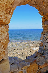 Fortress Window- Chania, Crete (Flortography) Tags: ocean blue sky beach yellow stone outdoors coast dock marine europe warf view horizon shoreline greece crete fortress chania astoundingimage