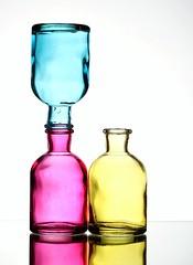 Show Off (Karen_Chappell) Tags: pink blue stilllife white glass yellow three bottle upsidedown bottles pastel vase balance