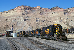 Gathering beneath the Book Cliffs (Moffat Road) Tags: railroad mountains up train utah ut cliffs unionpacific locomotive riogrande helper bookcliffs emd tunnelmotor sd40t2 drgw denverandriograndewestern enginefacility soldiersummitroute