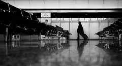 Hannover Airport (Dan-Schneider) Tags: street camera people urban blackandwhite bw photography prime europe candid streetphotography olympus scene best human moment schwarzweiss decisive schneider 17mm mft einfarbig omdem10