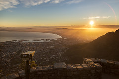 looking towards the future (timsnell) Tags: africa city blue light sky sun mountains water sunrise landscape southafrica warm wideangle capetown binoculars lensflare sunrays viewpoint tablemountain sunbeams